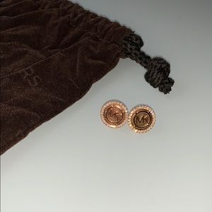 Rose gold Michael Kors stud earrings.
